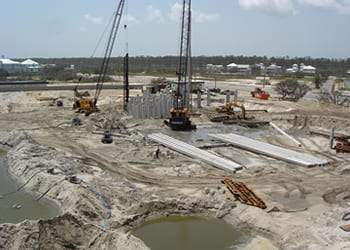 Photo of large construction site with cranes